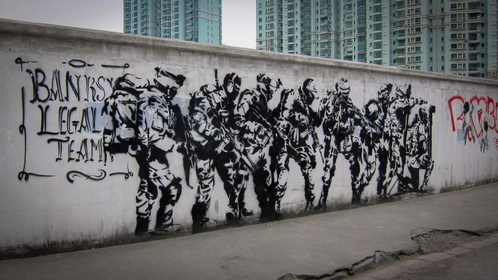 """stencil - banksy """"legal team"""" - shanghai"""